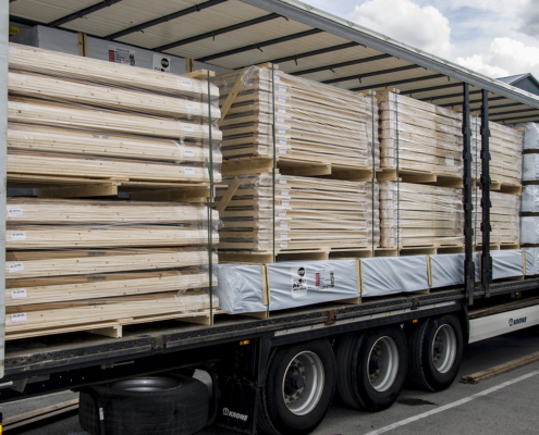 Log cabins, storage sheds, wooden doors & wooden windows ready for transport